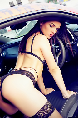 Sexy Girl Posing In Car By Eve Thompson